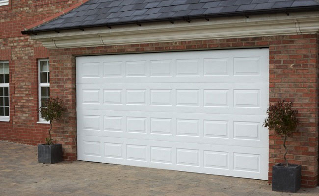Gliderol Georgian Sectional Garage Door painted white and fitted to large detached house