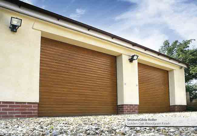 Seceuroglide roller shutter garage doors in golden oak