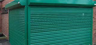 Galvanised roller shutter doors used to secure 2 shop fronts.