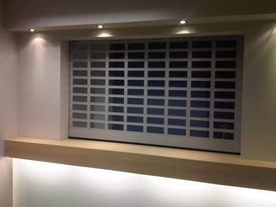SWS SeceuroVision 800 security roller shutter doors painted blue used to secure a commercial kitchen.