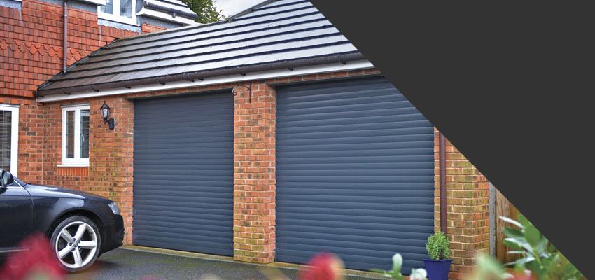 Anthracite Seceuroglide roller garage doors fitted to a double garage