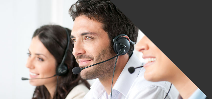 workers answering phones in call centre