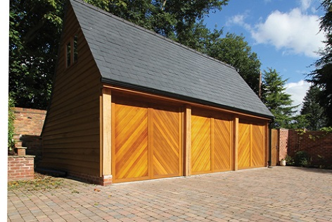 Chevron Boarded Up And Over Wooden Garage Doors Fitted Side By Side In A  Large Detached